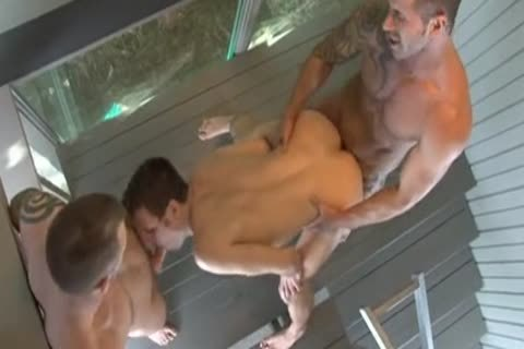 muscled men in gay threesome