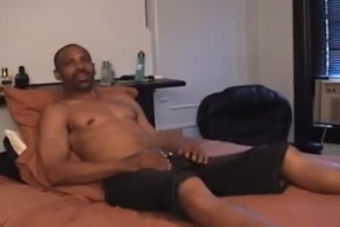 Super sweet black daddy undresses Off And Jerks his Monster black rod