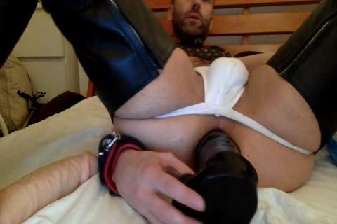 Here I am spreading My Legs Wide Open So A wicked Fucker Can bone Me With His bare jock.  he also Shoves Some thick Dildos In There And His Hand Often