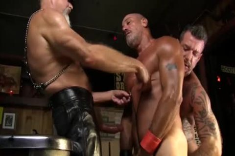 Leather Clad men poke Each Other On The Pool Table