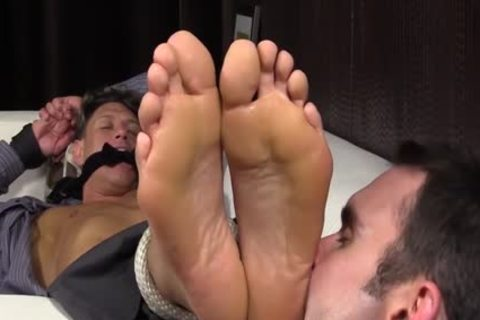 Bryce Evans Is tied Up And Has His Toes Licked On The couch