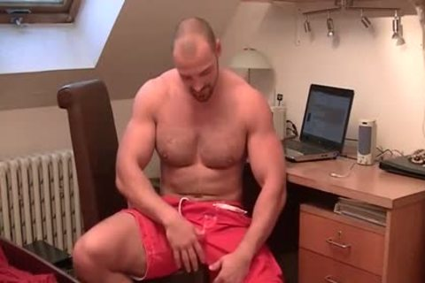 muscular man Strokes His beefy Tool