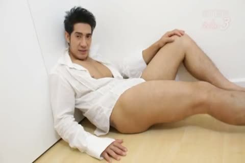 A Very good Asain paramour Interviews And Then Wanks His cock For All To see