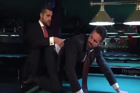 Two men In Suits Meet In A Bar