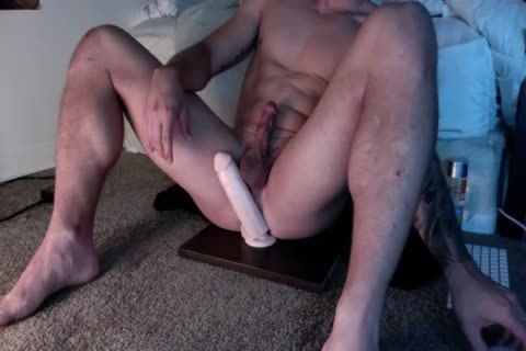 Muscle lad Riding A fake penis