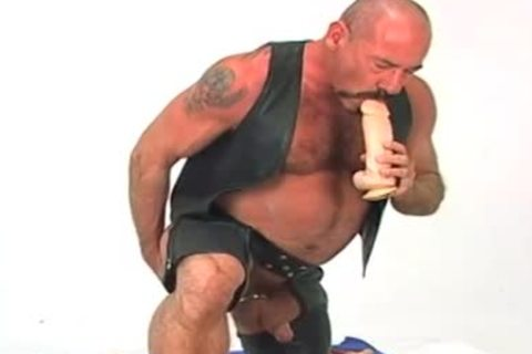 Butch leatthis chabr wearing mature fellow w/ massive dildo