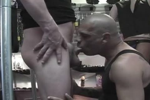 Bald dudes sharing irrumation-job in a sex shop