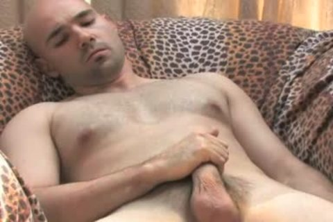 Bald hunk plays with hellos knob